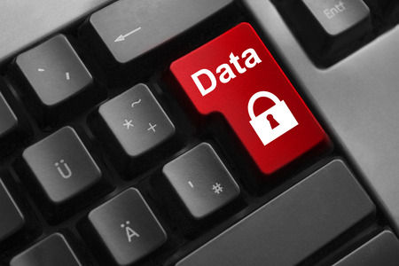 personal data privacy issues: dark keyboard red button data security lock symbol