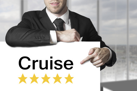 businessman pointing on sign cruise gold rating stars photo