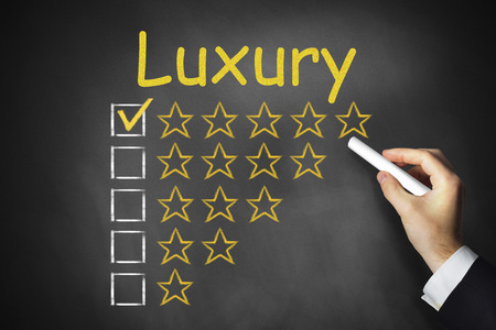 proved: hand writing luxury on black chalkboard golden rating stars