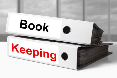 stack of two white office binders bookkeeping photo