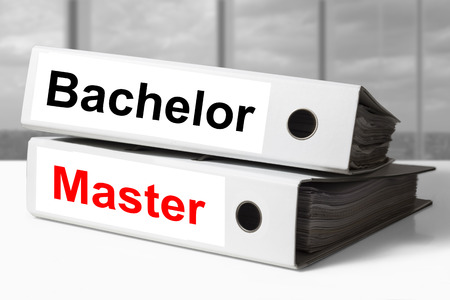master degree: stack of two white office binders bachelor master graduation degree