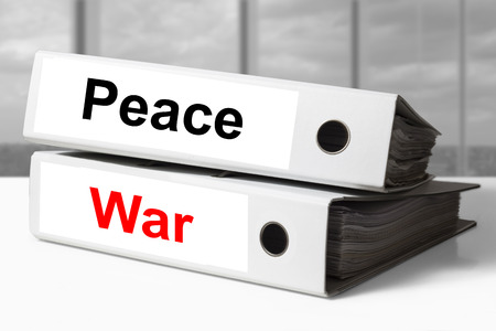 stack of two white office binders peace war photo
