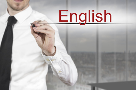 latin language: businessman translator in office writing english in the air Stock Photo