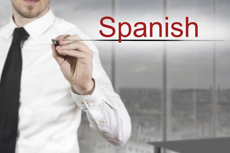 transnational: businessman in office writing spanish in the air Stock Photo