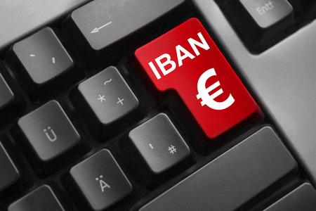 international bank account number: dark grey keyboard red button iban euro symbol Stock Photo