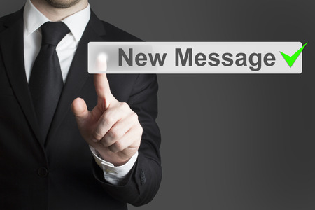 new message: businessman in black suit pushing flat touchscreen button new message