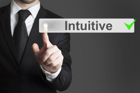 businessman in black suit pushing flat touchscreen button intuitive usage Standard-Bild