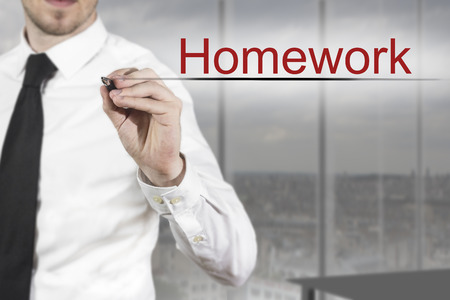 businessman in office writing homework in the air