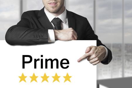 proved: businessman in black suit pointing on sign prime golden rating stars