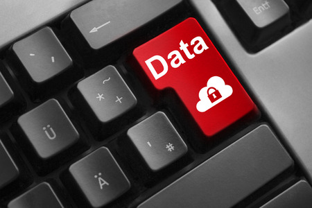 personal data privacy issues: dark grey keyboard red enter button data cloud security