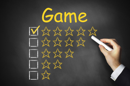 bandwith: hand writing game on black chalkboard golden star rating Stock Photo
