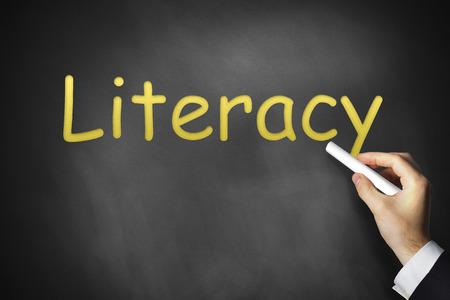 hand writing literacy on black chalkboard education photo