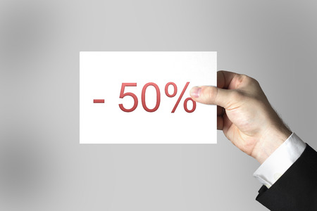 businessman hand holding card fifty percent discount photo