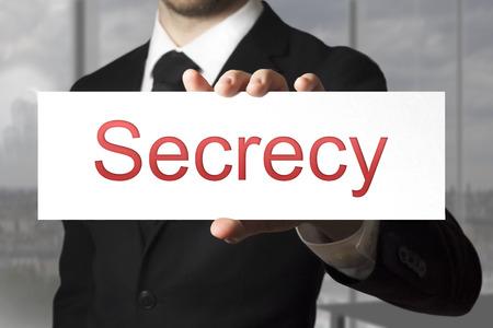 sigilo: empres�rio de terno preto segredo sinal explora��o Banco de Imagens