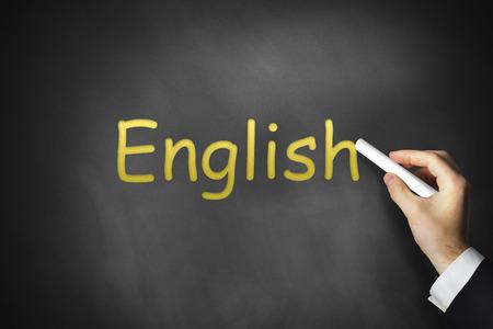 hand writing english on black school chalkboard