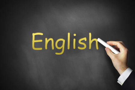 transnational: hand writing english on black school chalkboard
