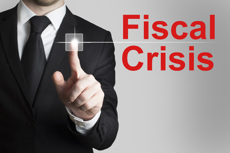 failed politics: businessman in black suit pushing button fiscal crisis