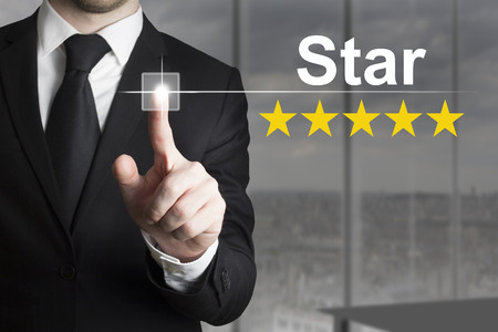 businessman pushing button star celebrity five stars