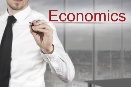 failed plan: businessman in office writing economics in the air