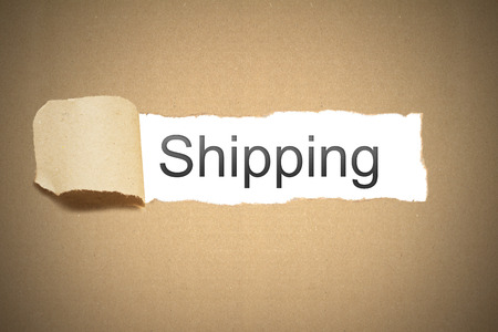 brown packaging paper torn to reveal shipping photo
