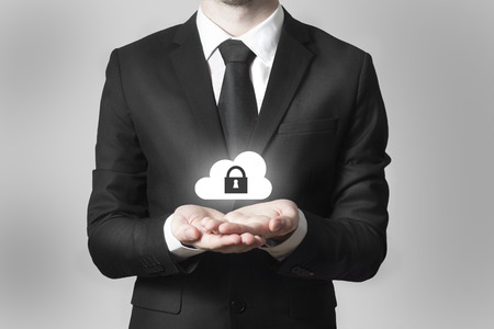 businessman in black suit serving gesture cloud security symbol 版權商用圖片