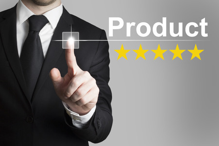 pushing button: businessman in black suit pushing button product rating stars Stock Photo