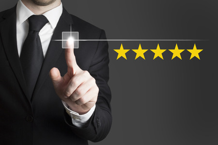 best guide: businessman in black suit pushing button five star rating