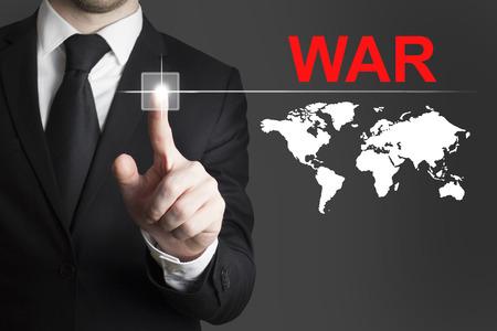 transnational: businessman in black suit pushing button war international world