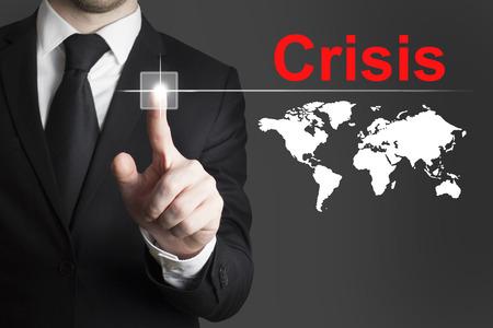 failed politics: businessman in black suit pushing button crisis global