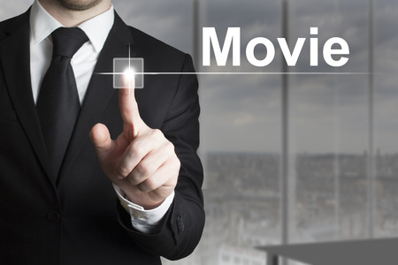 pushing button: businessman in black suit pushing button movie