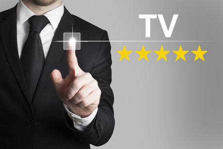 five stars: businessman in black suit pushing button tv five rating stars