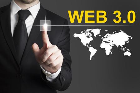 pushing button: businessman in black suit pushing button web 3.0 internet global Stock Photo