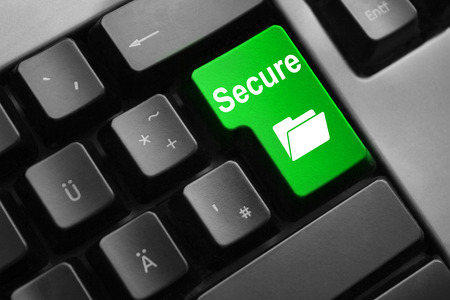personal data privacy issues: dark grey keyboard green button secure folder