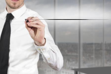 underline: businessman in black suit drawing line in the air underline