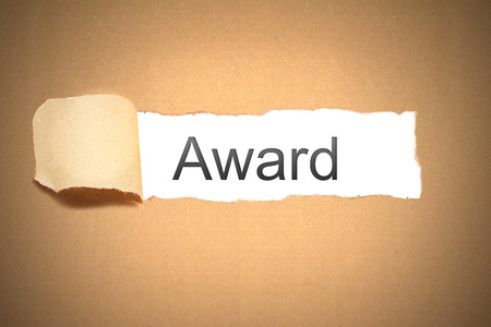 proved: brown paper envelope torn to reveal award Stock Photo