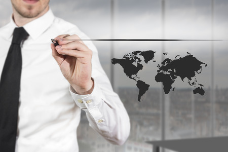 worldmap: businessman in office drawing line and worldmap in the air Stock Photo