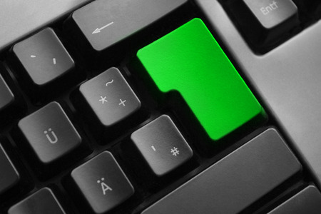personal data privacy issues: dark grey keyboard empty green enter button Stock Photo