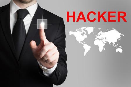 cyberwar: businessman in black suit pushing button hacker worldmap international