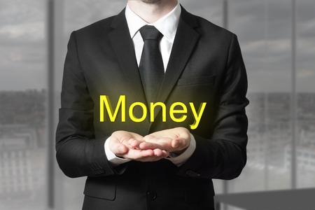 begging: businessman in black suit begging gesture money