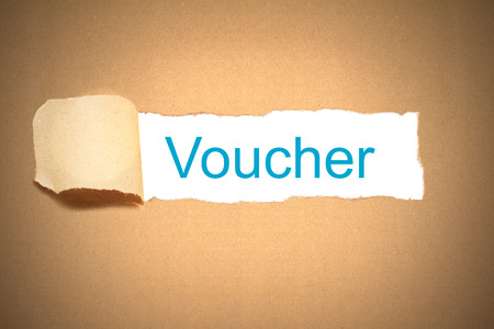 reveal: brown envelope paper torn to reveal voucher Stock Photo