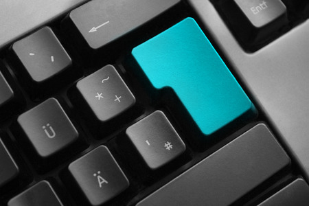 personal data privacy issues: dark grey keyboard teal colored enter button Stock Photo