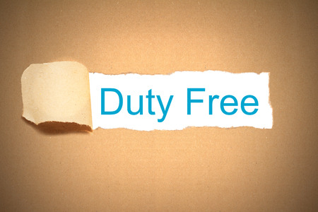 reveal: brown envelope paper torn to reveal duty free Stock Photo