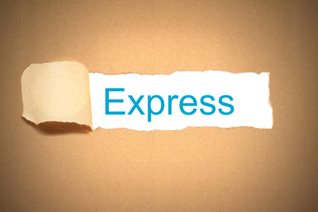 reveal: brown package paper torn to reveal express Stock Photo