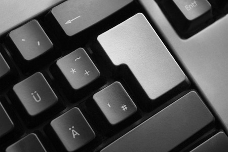personal data privacy issues: dark grey keyboard with silver colored enter button