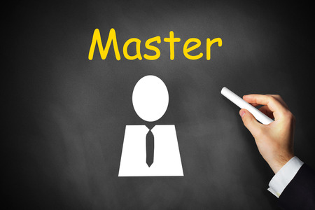 master degree: businessmans hand writing master on black chalkboard
