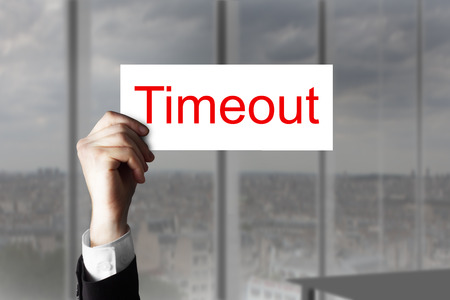 challange: hand in office holding up sign timeout