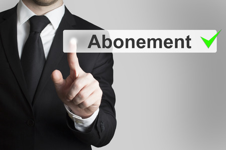 newsfeed: businessman in black suit pushing button abonement