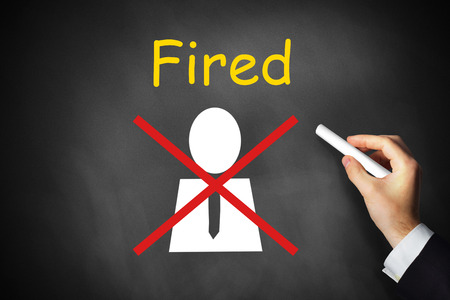 unemployed dismissed: businessmans hand crossing out employee fired