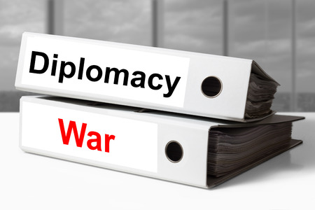 diplomacy: stack of white office binders diplomacy war