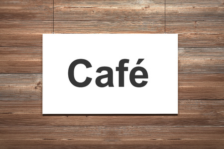 white canvas hanging on wooden wall cafe photo